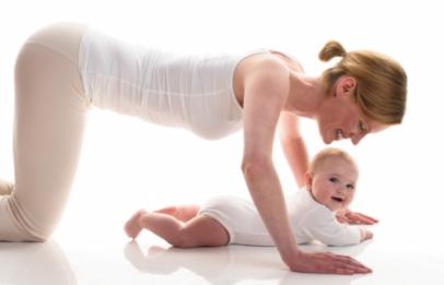 Baby doing yoga with mom